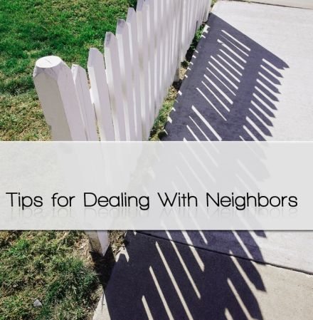High angle view of a white picket fence and shadow
